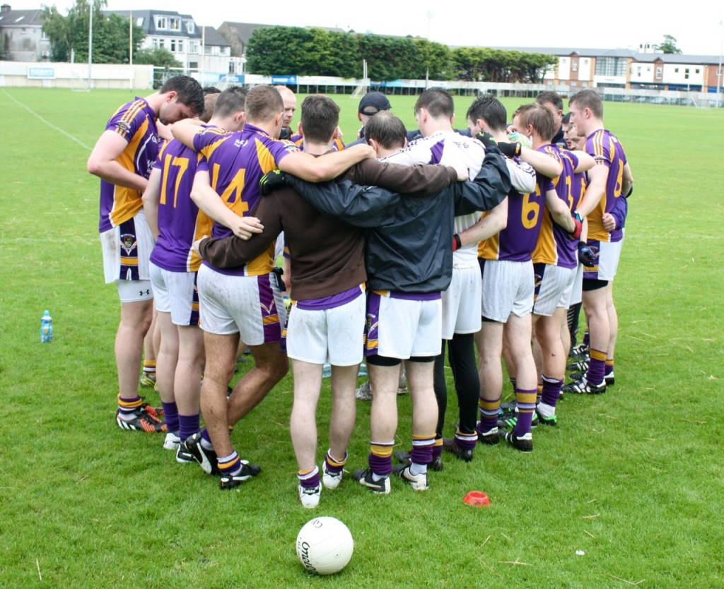Kilmacud Crokes team huddling together before a game.