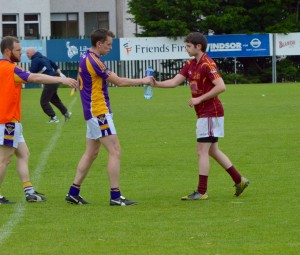 Kilmacud Crokes player sharing water with opponent
