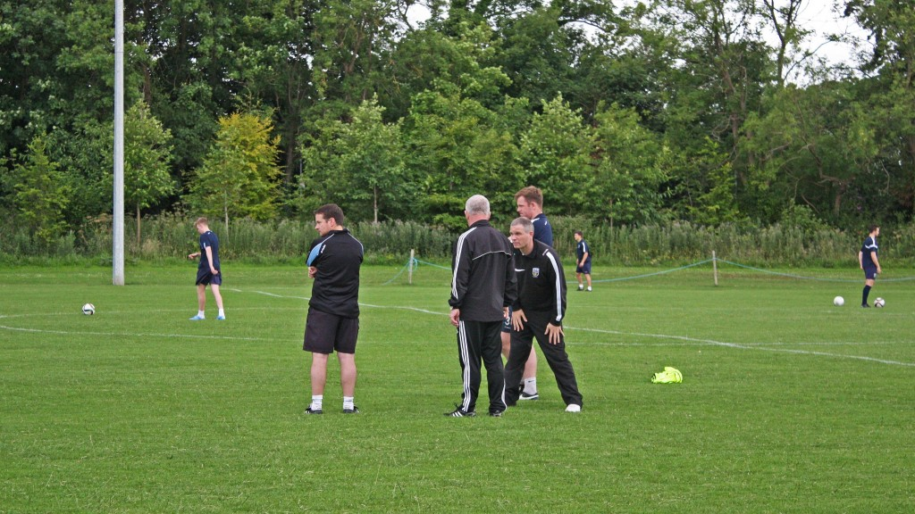 From left to right: Collie O'Neill (1st team manager), Pat Devlin (director of soccer), Diarmuid McNally (program development officer) and Gerrard Barron (1st team goalkeeping coach) observing the boys as they practice their skills